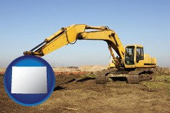 wyoming map icon and excavation project equipment
